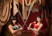 Belly Dancers Holding Swords — Stock Photo