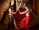 Beautiful Belly Dancers With Swords — Stock Photo