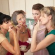 Stock Photo: Four Women Smoking