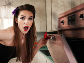 Surprised Housewife Checks the Oven — Stock Photo