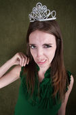Disgusted Young Woman in Crown — Stock Photo