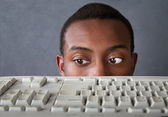 Eyes of Man Above Keyboard — Zdjęcie stockowe