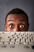 Surprised Eyes of Man Above Keyboard — Stockfoto