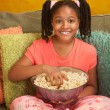 Stock Photo: Little Kid Eats Popcorn