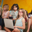 Stock Photo: Little Girl Using Laptop