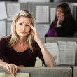 Woman in Office with Headache — Stock Photo #40723235