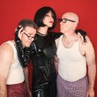 Stock Photo: Dominatrix with Two Men
