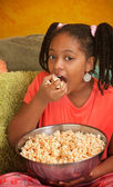 Little Girl Eats Popcorn — Stock Photo
