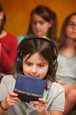 Little Girl Plays a Video Game — Stock Photo