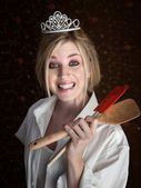 Grinning Lady Holding Spatulas — Stock Photo