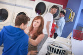 Couple Arguing In Laundromat — Stock Photo