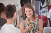 Flirting Woman in Laundromat — Stock Photo