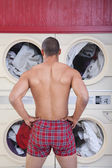 Muscular Man In Laundromat — Stock Photo