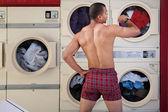 Half-naked Man in Laundromat — Stock Photo