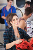 Young Woman in Laundromat — Stock Photo