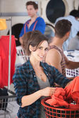 Smiling Woman in Laundromat — Stock Photo