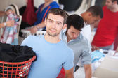 Blue-Eyed Man In Laundromat — Stock Photo