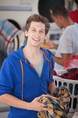 Smiling Man In Laundromat — Stock Photo
