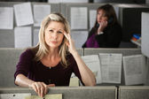 Woman in Office with Headache — Stockfoto