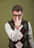 Nerd Adjusting Eyeglasses — Stock Photo