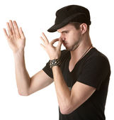 Young Man Pinches His Nose — Stock Photo