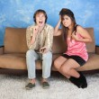 Annoyed Young WomWith Loud Boy — Stock Photo #40887127