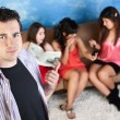 Annoyed Young Man and Ladies — Stock Photo