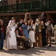 People outside a building in old west costumes — Stock Photo #40888209