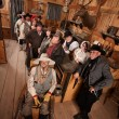 Relaxed Crowd with Guns in Saloon — Stock Photo #40888483