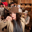 Cowgirl Sips Whiskey in Tavern — Stock Photo