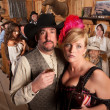 Cowboy and Showgirl Drinking — Stock Photo