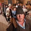 Serious Cowboy with Rifle in Saloon — Stock Photo