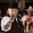 Old Western Smoking Man with Gun — Stock Photo #40889391
