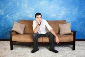 Bored Man on Sofa — Stockfoto