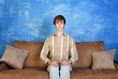 Stiff Young Man on Sofa — Stock Photo
