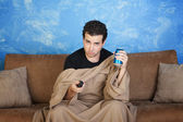 Bored Man With Remote Control — Stock Photo