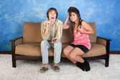 Annoyed Young Woman With Loud Boy — Stock Photo