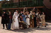 People outside a building in old west costumes — Stock Photo