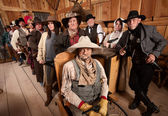 Serious Group of People in Old West Tavern — Stock Photo