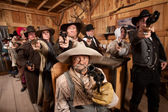 People Aiming Guns at Camera in Saloon — Stock Photo