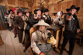 Tough People with Guns in Old Saloon — Stock Photo