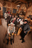 Relaxed Crowd with Guns in Saloon — Stock Photo