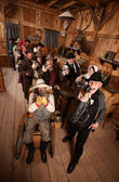 Rowdy Crowd with Guns in Saloon — Stock Photo