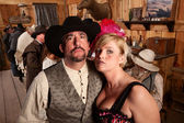 Tough Cowboy and Showgirl in Saloon — Stock Photo