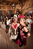 Trapper and Showgirl in Saloon — Stock Photo