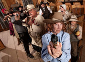 Group of Cowboys Point Guns in Bar — Stock Photo
