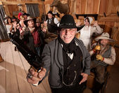 Happy Sheriff Arrests Group in Saloon — Stock Photo