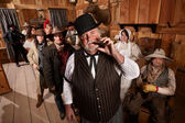 Tough Saloon Boss with Customers — Stock Photo