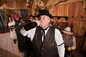 Thirsty Drunkard in Saloon — Stock Photo