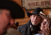 Cowboy in Crowded Room — Stock Photo